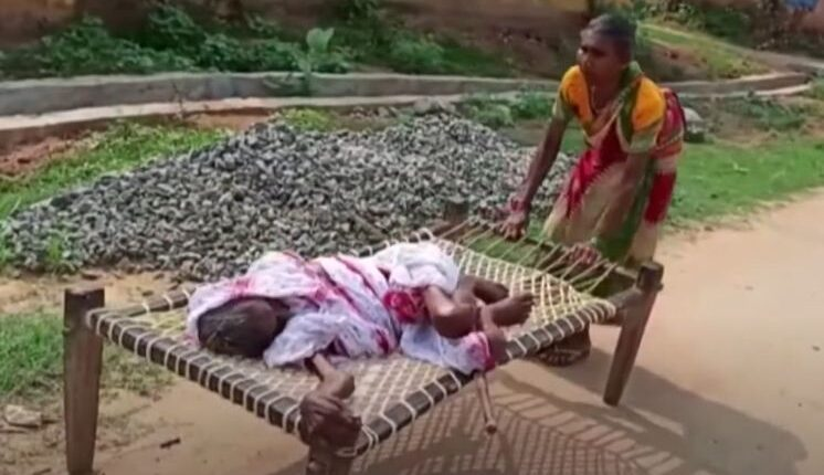 70-year-old woman drags mother on cot to bank