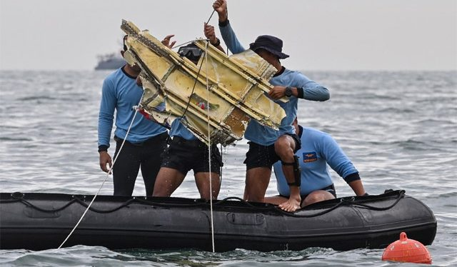 Human body parts retrieved from Indonesian plane crash site